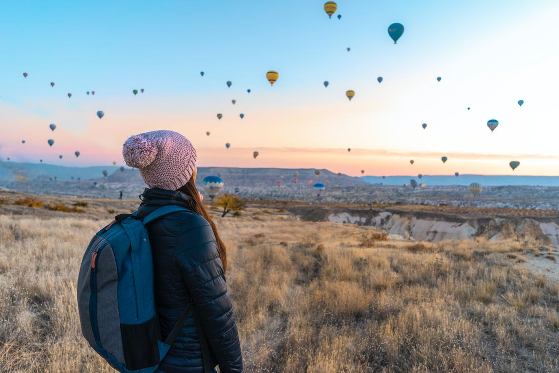 Woman Looking At Hot Air Balloons