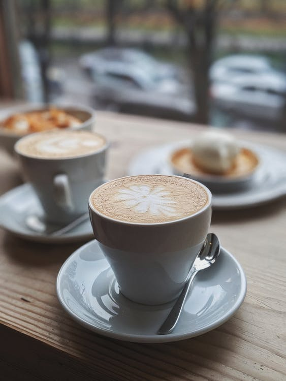 Selective Focus Photography of Coffee With Latte Art