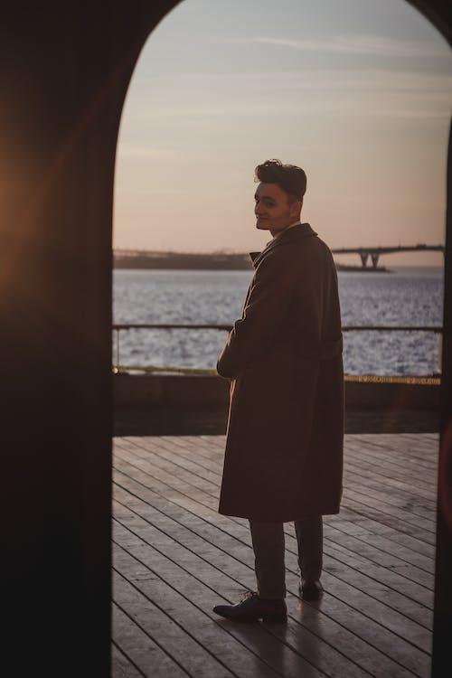 Man Wearing Brown Trench Coat
