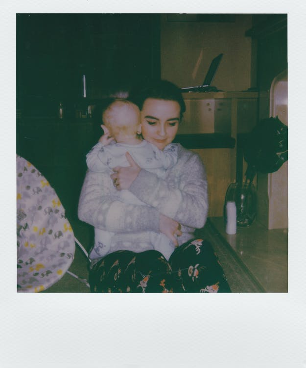 Sitting Woman Holding Baby Screenshot