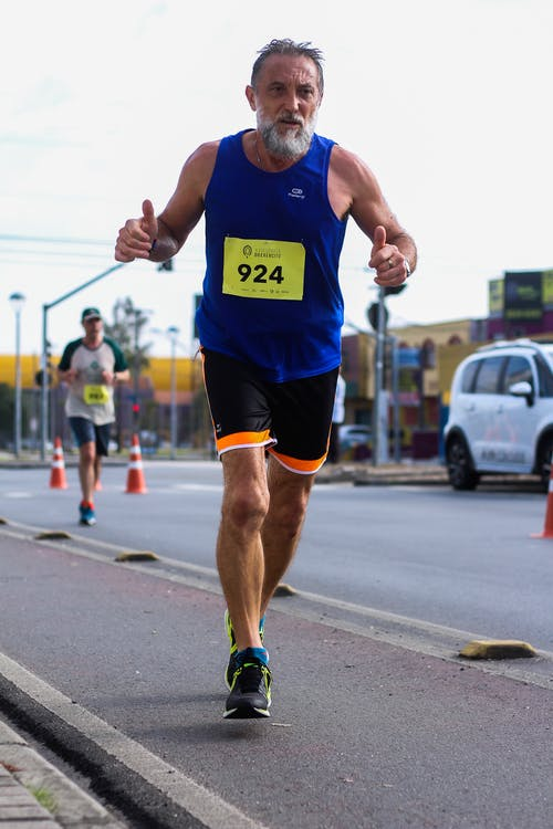 Man Running Marathon Doing Two Thumbs Up