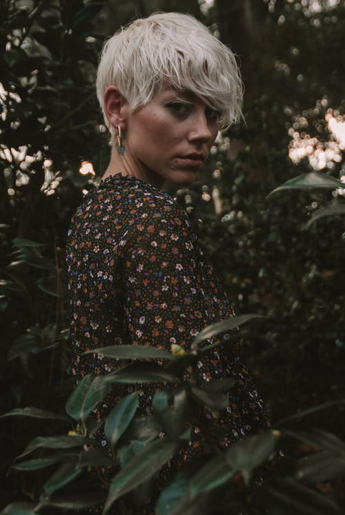 Portrait Photography of Woman Surrounded by Plants