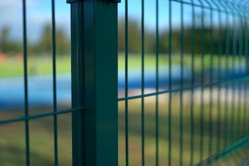 Free stock photo of blurry background, bokeh, fences, grass
