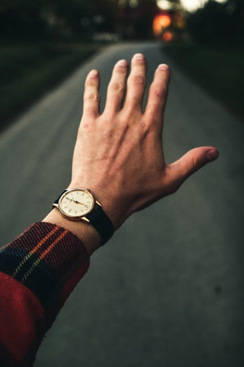 Photo of Person Wearing Analog Watch