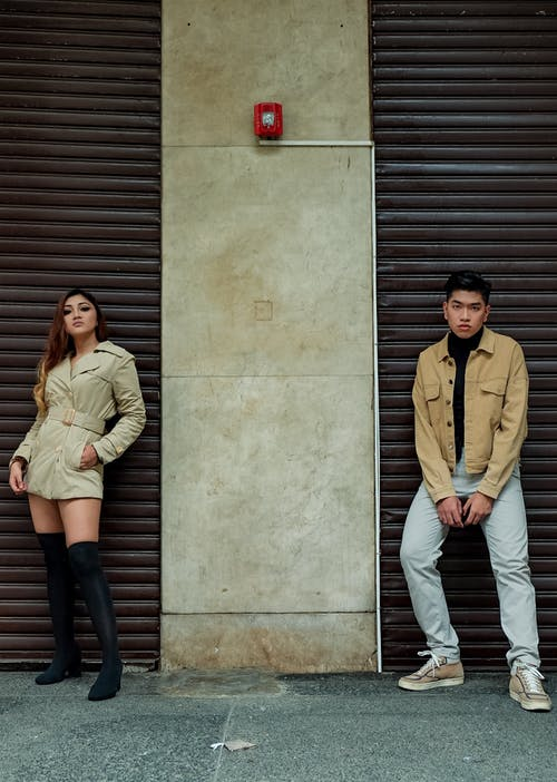 Man and Woman Standing Beside Wall