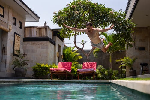 Man Jumping on Pool