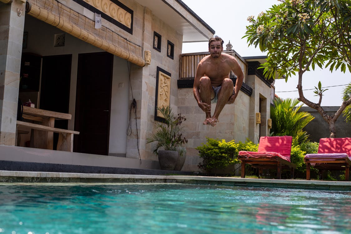 Man Jumping Into The Pool