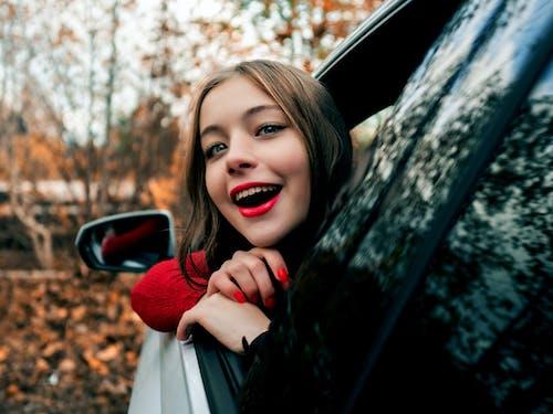 Woman Looking Outside Vehicle's Window