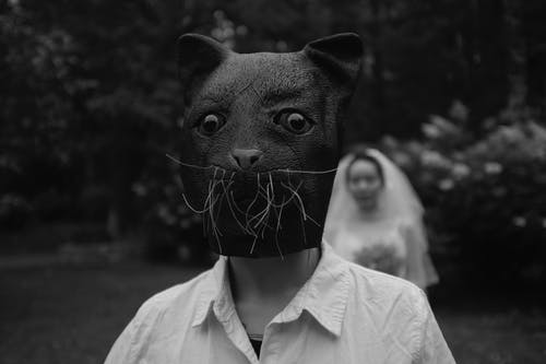 Grayscale Photo of Person Wearing Dog Mask