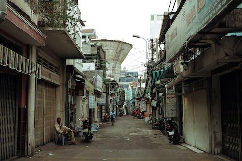 Foto stok gratis Arsitektur, bangunan, gang, jalan