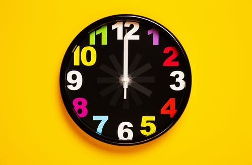 Black and Yellow Analog Clock