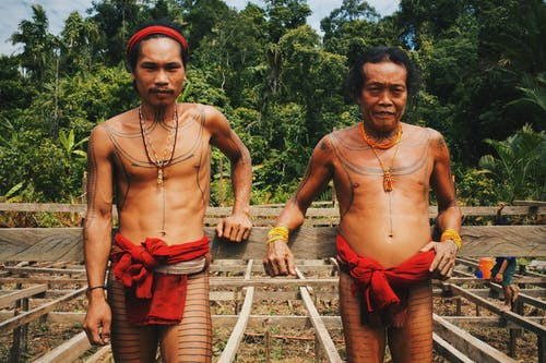 Two Men Wearing Red Tribal Clothing