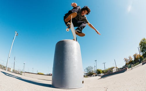 Man Doing A Trick In Skateboard
