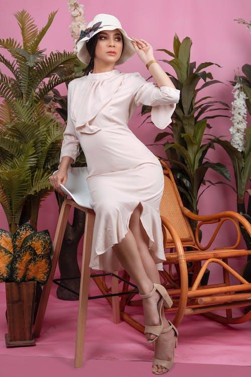 Woman Sitting on Stool