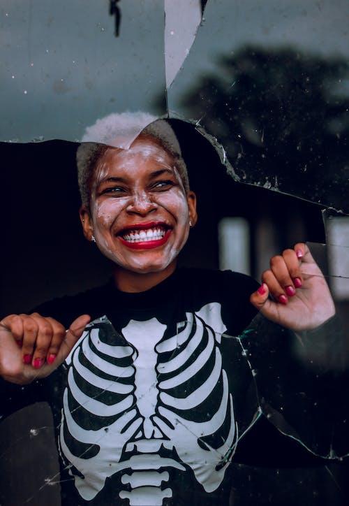 Woman Smiling Behind Broken Glass Window