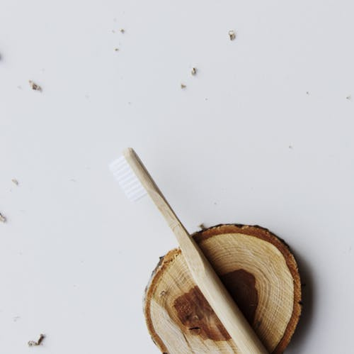 Photo Of Wooden Toothbrush On Top Of Wooden Plank