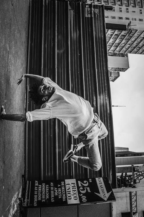 Monochrome Photo Of Man Touching Ground