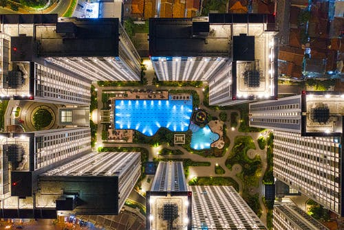 Aerial Photography of High Rise Building and Swimming Pool