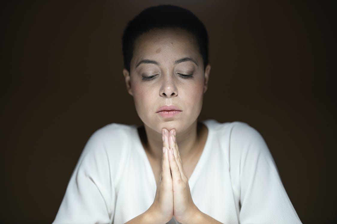 Woman Wearing White Long-sleeved Shirt Prayng