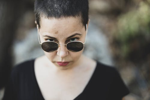 Woman In  Black Scoop-neck Shirt With Sunglasses