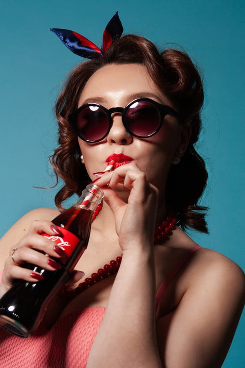 Woman Drinking Coca-cola