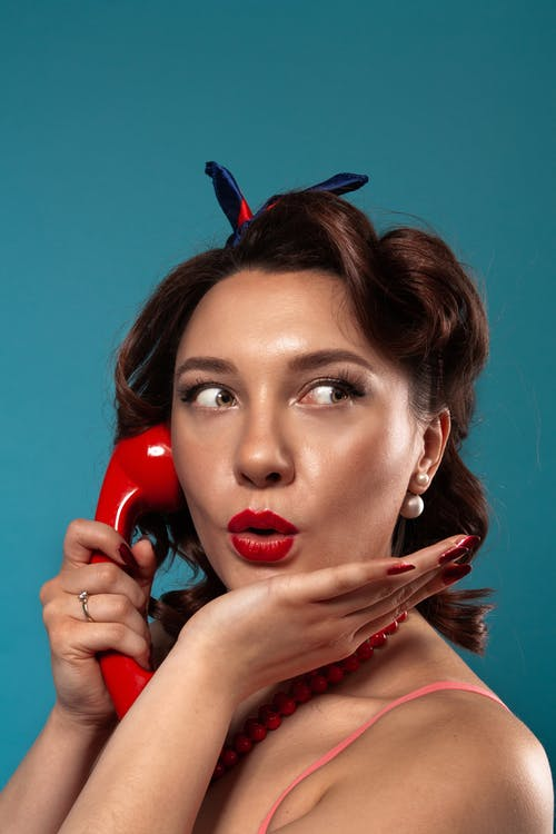 Portrait Photography of Woman Answering a Telephone