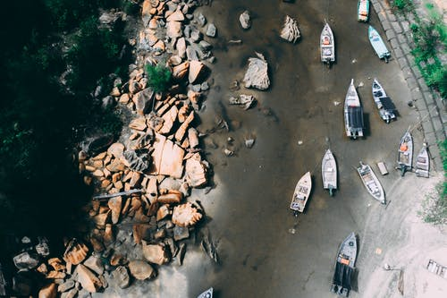 Boats On A Shallow River