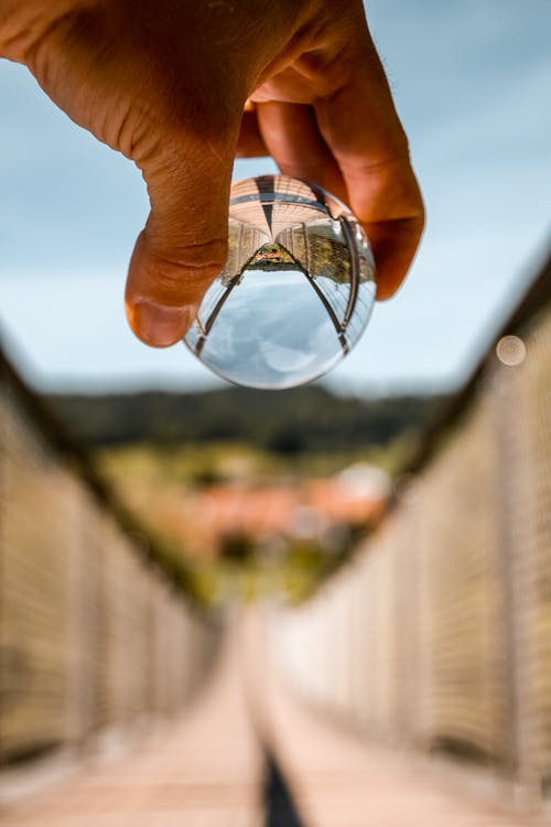 Person Holding Lensball