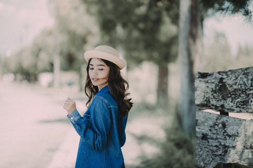 Woman in Blue Denim Jacket Standing Outdoors