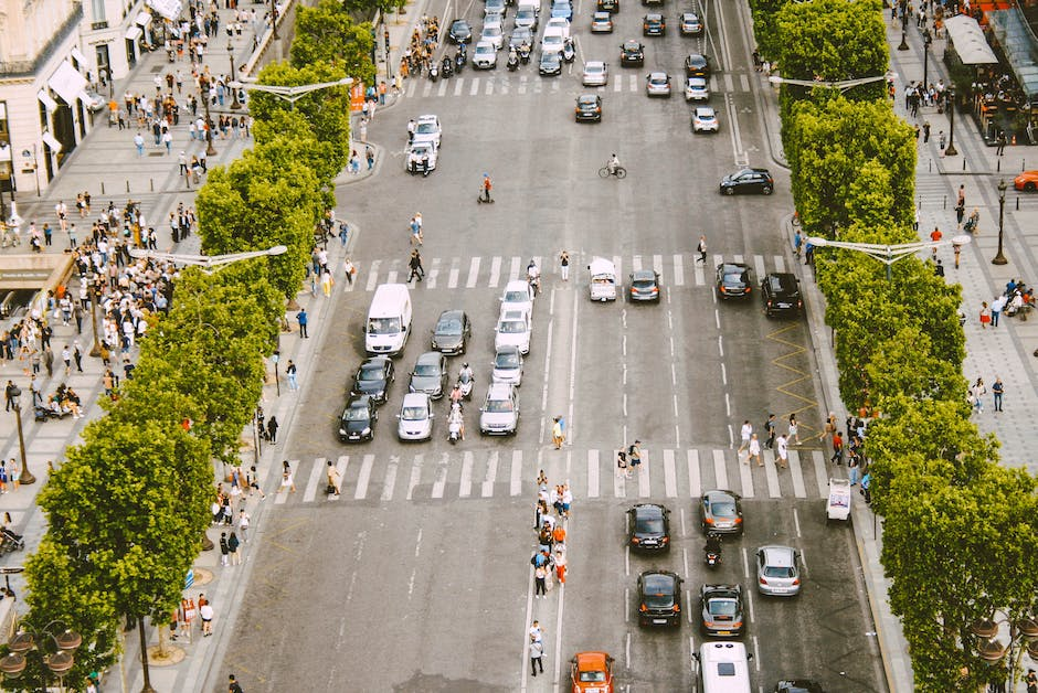 High angle shot of cars and people on the road