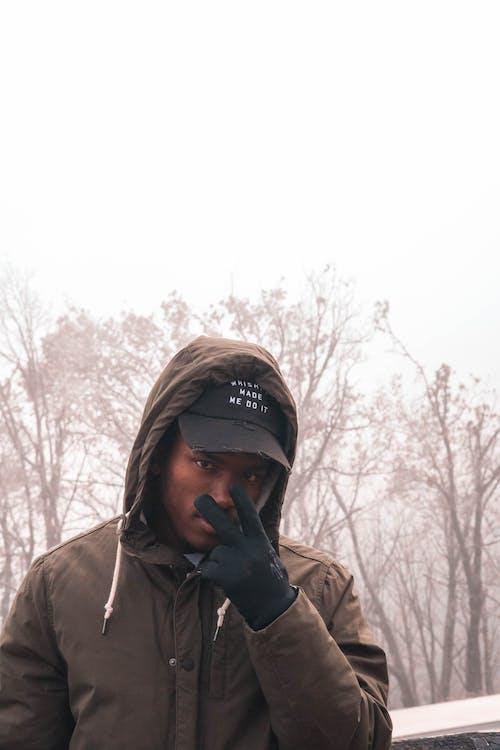 Man Wearing Brown Hooded Jacket