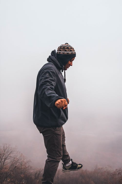 Man Surrounded With White Fog