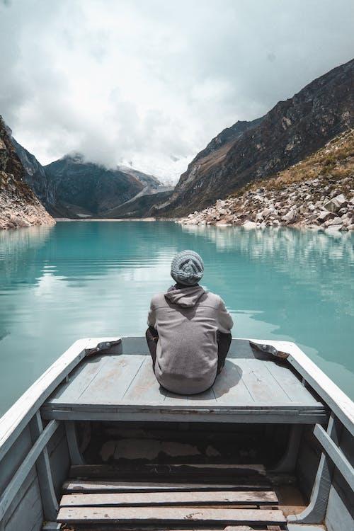 Photo Of Man Sitting On Boat