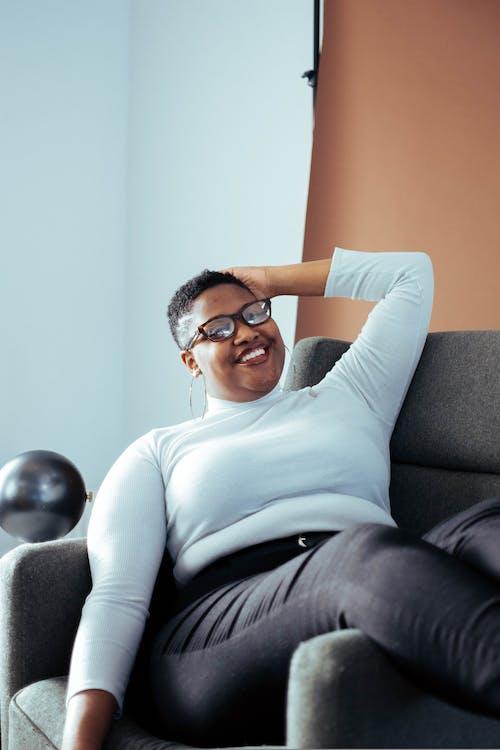 Woman Siting on Sofa Chair