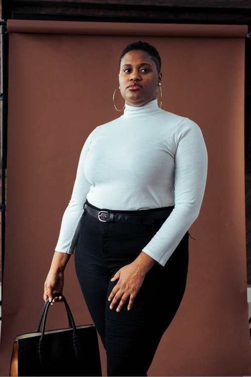 Woman in White Blouse and Black Pants Photo