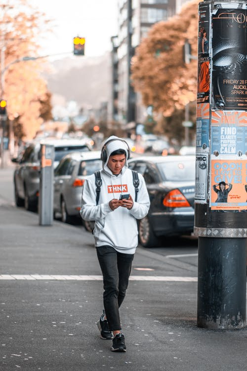 Man Walking on Sidewalke