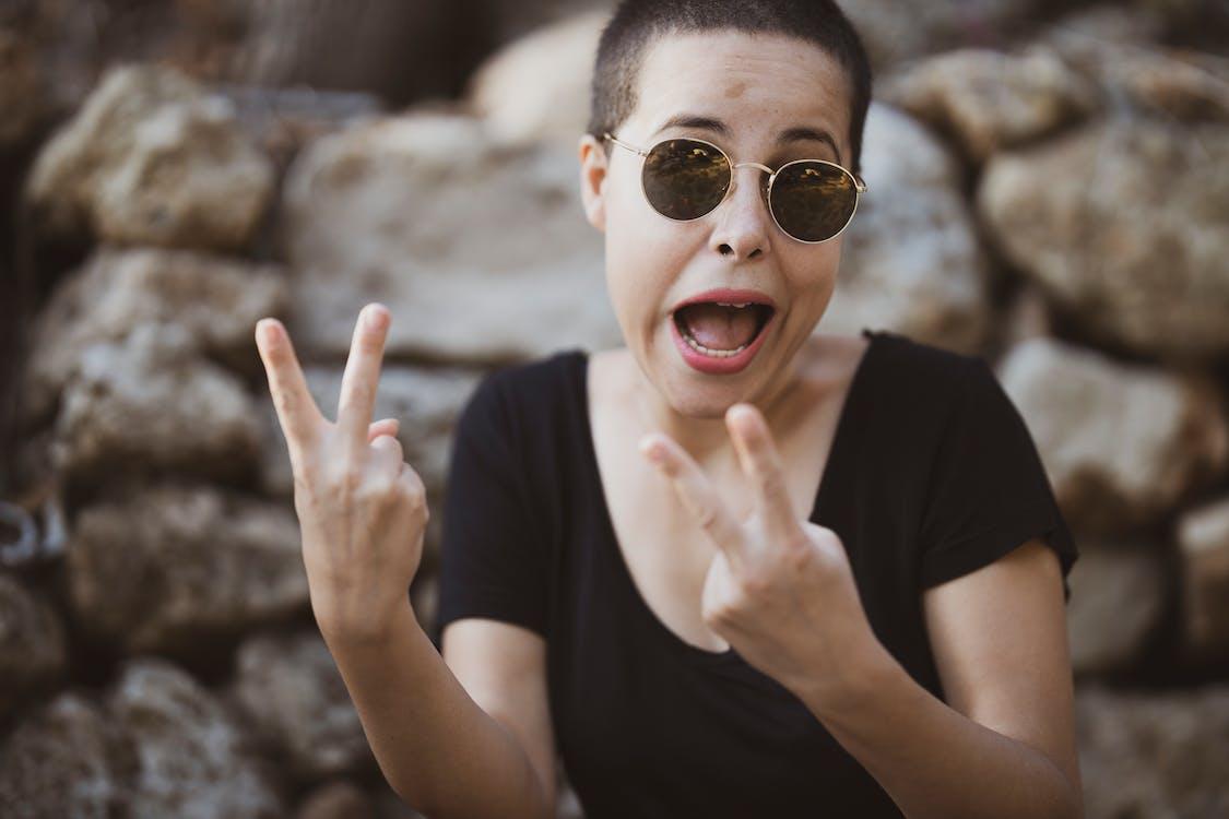 Woman Wearing Black Scoop-neck Blouse