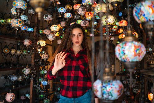 Woman Surrounded by Mosaic Glass Lanterns