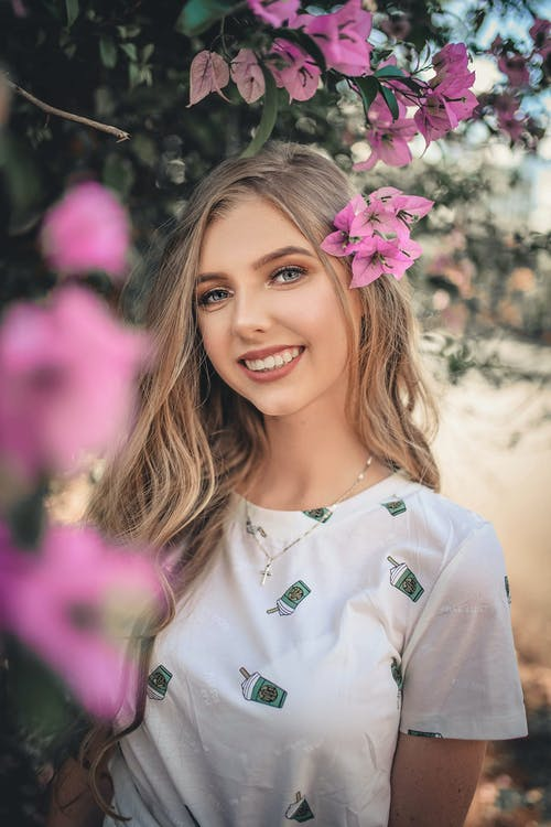 Photo Of Woman Near Flowers