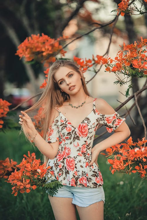 Photo Of Woman Wearing Floral Top