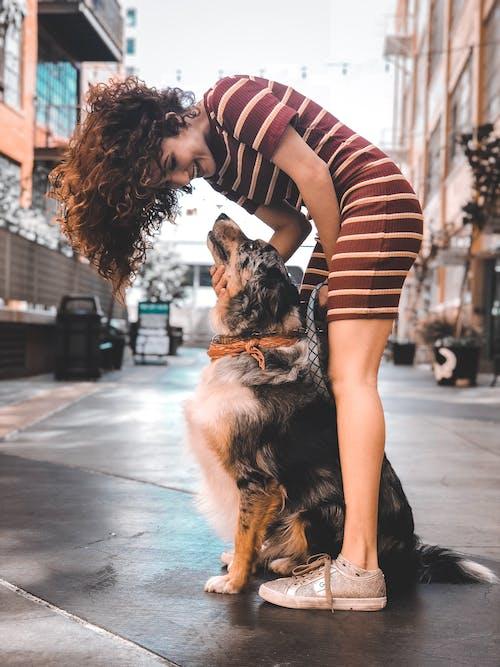 Photo Of Woman Holding Dog