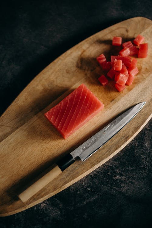 Sliced Strawberry on Brown Wooden Chopping Board