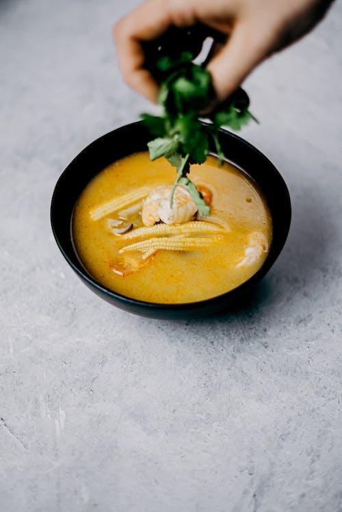 Soup in A Black Bowl