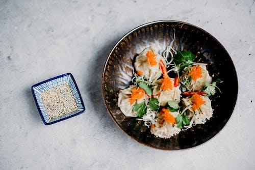 Dumplings With Veggies in Brown Bowl