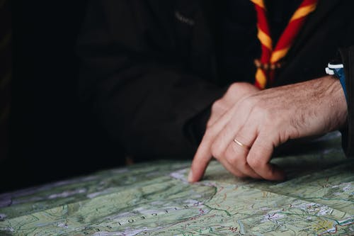 Photo of Man Pointing on the Map