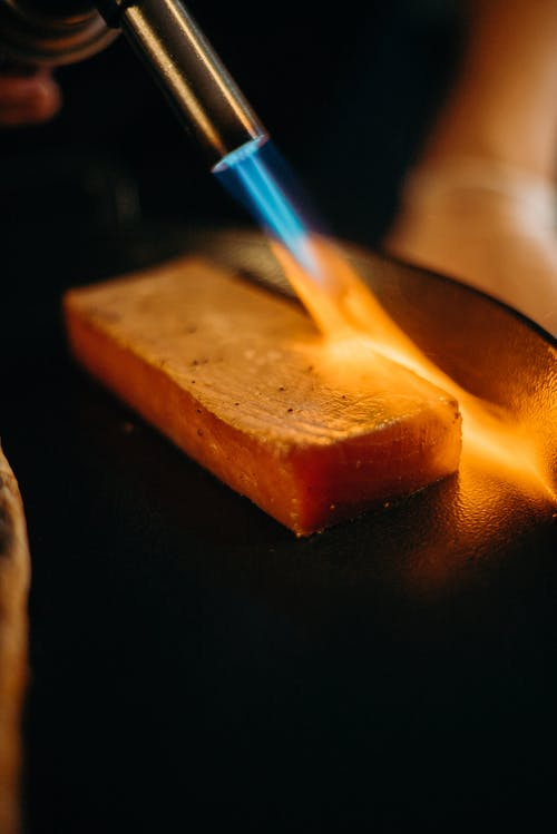 Photo Of Person Burning Salmon