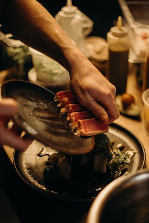 Photo Of Man Holding Sushi