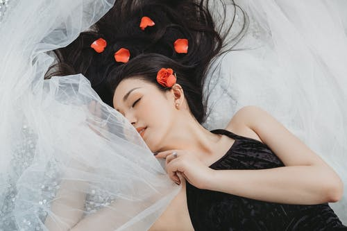 Photo Of Woman Laying On Veil