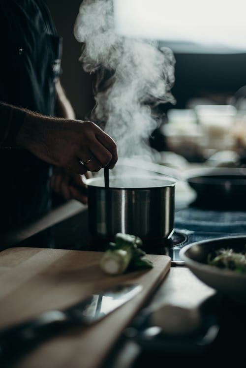 Person Cooking in Pot