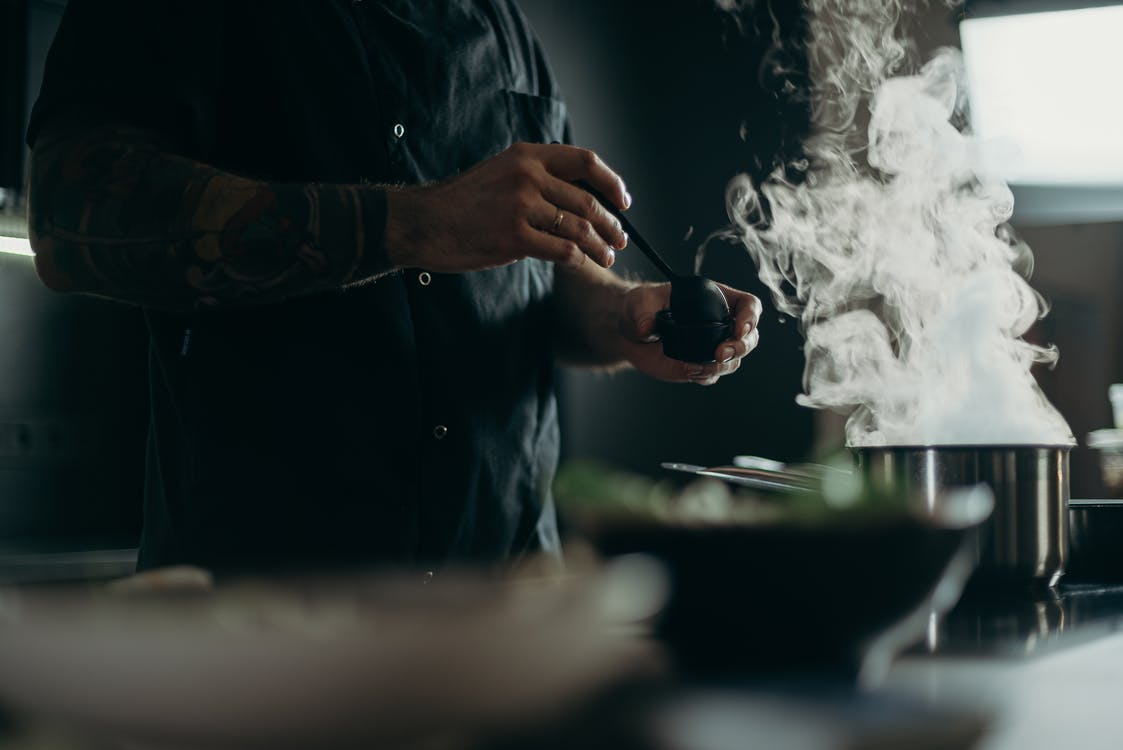 Man Cooking Food